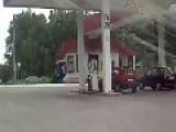 Woman Driver At The Petrol Pump