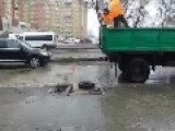 Workers Try To Fix Flooded Road