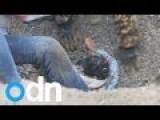 Watch Chinese Rescuers Free Boy Trapped In Gravel Pit