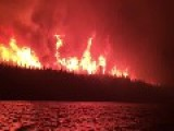 Wildfire Rages Along Canadian Lake