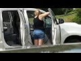 Woman Spray Washes Inside Her Truck