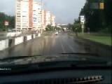 Wet Road Causes Bizarre Accident