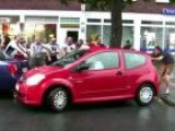German Soccer Fans Cheer On Woman Parking Car
