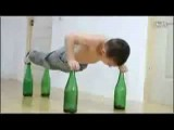 Boy Does Pushups On Bottles