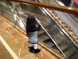 Chloe Says Bye To People On The Escalator
