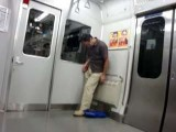 Japanese Guy Falls Asleep Standing Up