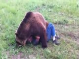 Man Cuddles With A Big Ass Grizzly Bear