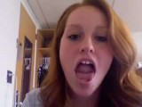 Redhead Shows Off Her Tongue Skills