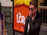 Zac Efron Drops A Condom On The Red Carpet
