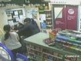 CCTV: Incredible Moment Shopkeeper Jumps On Axe-wielding Robber And Takes Him Down