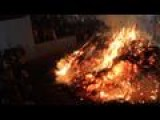 Hindu Priest Runs Over Giant Fire As Part Of Holi Festival