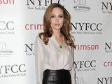 E! News Now Angelina Jolie Sizzles In Sexy Leather Skirt