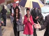 Kim And Kourtney Kardashian Brave The Rain In L.A
