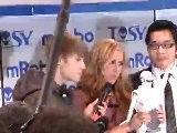 Justin Bieber Debuts New Tosy Robot At CES 2012