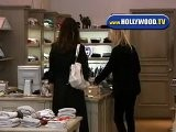 Milla Jovovich Shopping For Baby Clothes