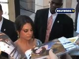 Mila Kunis Signs Autographs At For Fans