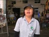 Thai Workers Assess Flood Damage As Waters Recede