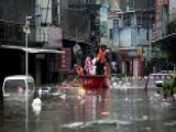 Floods In Southern China Displace Thousands