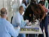 Calls For Travel Ban Mount Amid Ebola Fears
