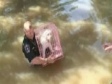 First Responders Rescue Animals In Harvey Flood Zone
