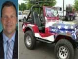 Left Slams Kris Kobach For Fake Gun On Jeep
