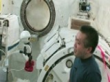 Astronaut Says Goodbye To Cute Talking Robot Companion