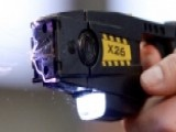 A Closer Look At The Controversial History Of The Taser