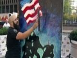 Artist Paints Mural While Singing The National Anthem