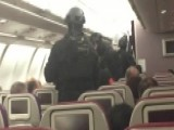 Armed Police Storm Plane, Carry Man Away After Bomb Threat