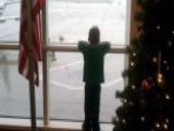 Boy Awaits Military Dad