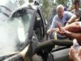 Bystanders Rush To Help Free Women From Burning SUV