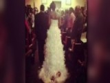 Bride Walks Down Aisle With Newborn Tied To Bottom Of Dress