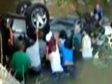 Bystanders Rescue Teens Trapped In Overturned SUV In River