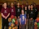 Basketball Team Protects Disabled Cheerleader From Bullies