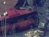 Bus Crashes Into Building In Queens, New York
