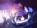 Brave Cops, Civilians Pull Occupants From Burning Car