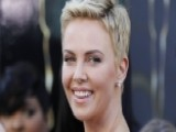 Charlize Steps Out In A Skimpy Bikini