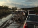 Calif. Flooding Traps Vehicles, Leaves Drivers Stuck In Mud