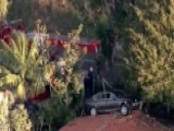 Car Crash Lands On Roof In California