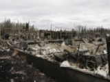 Cool Weather, Rain Help In Alberta, Canada Wildfire Battle