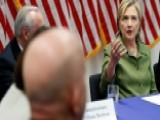 Clinton Holds Roundtable With Law Enforcement Officials
