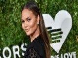 Chrissy Teigen: I Hold My Baby Fine