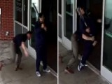Cop Blindsides Bat-wielding Man Outside Police Department
