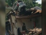 Car Crashes Onto The Roof Of St. Louis Home