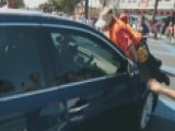 Car Drives Through Group Of Immigration Protesters