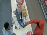 Cashier Stares Down Armed Robber