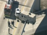 Camper Trailer Dangles Precariously Over Highway Overpass