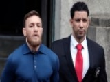 Conor McGregor Exits Brooklyn Police Station In Handcuffs
