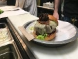 Customers Go Crazy Over Burgers Topped With Tarantulas