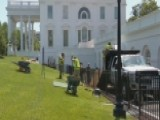 Crew Works To Fill In White House Sinkhole